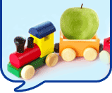 image of a toy train and an apple