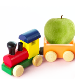 image of wooden train with apple