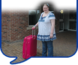image of lady with suitcase
