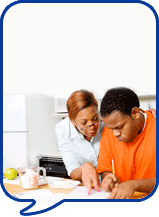 image of two people doing paperwork