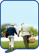 image of couple walking in field